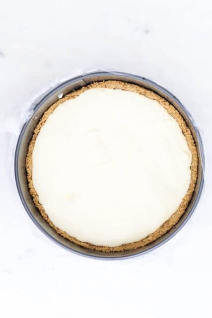 overhead view of a cheesecake batter in a pan