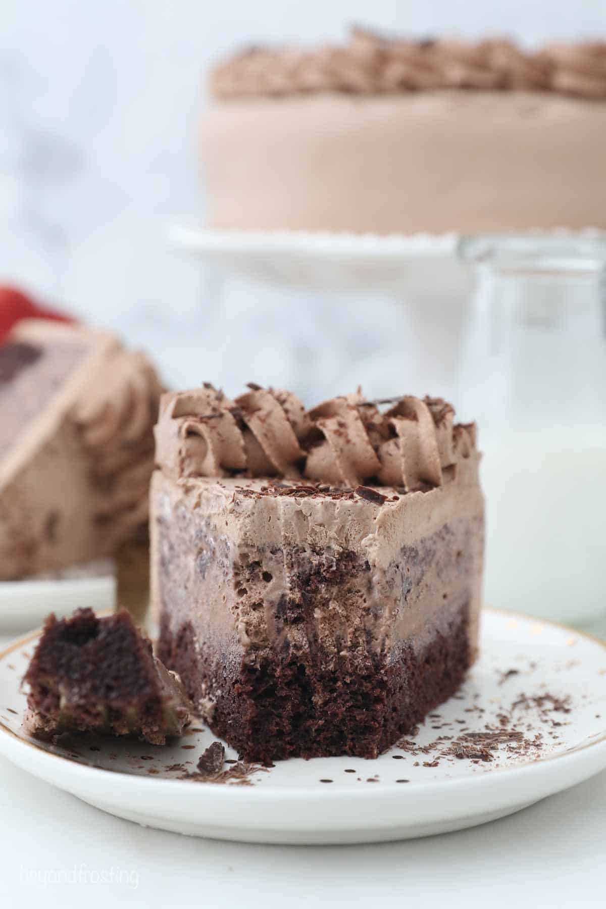 a slice of layered chocolate cake with a bite missing