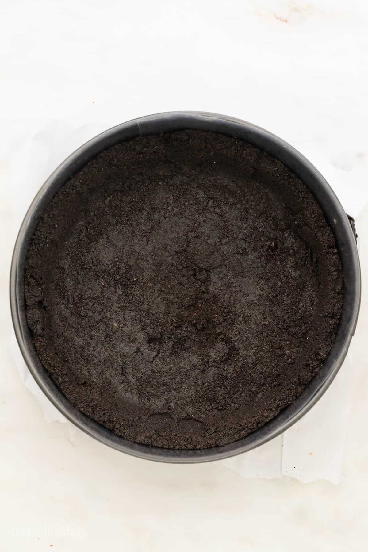 A Bird's Eye View of an Oreo Cookie Crust Pressed Into a springform pan