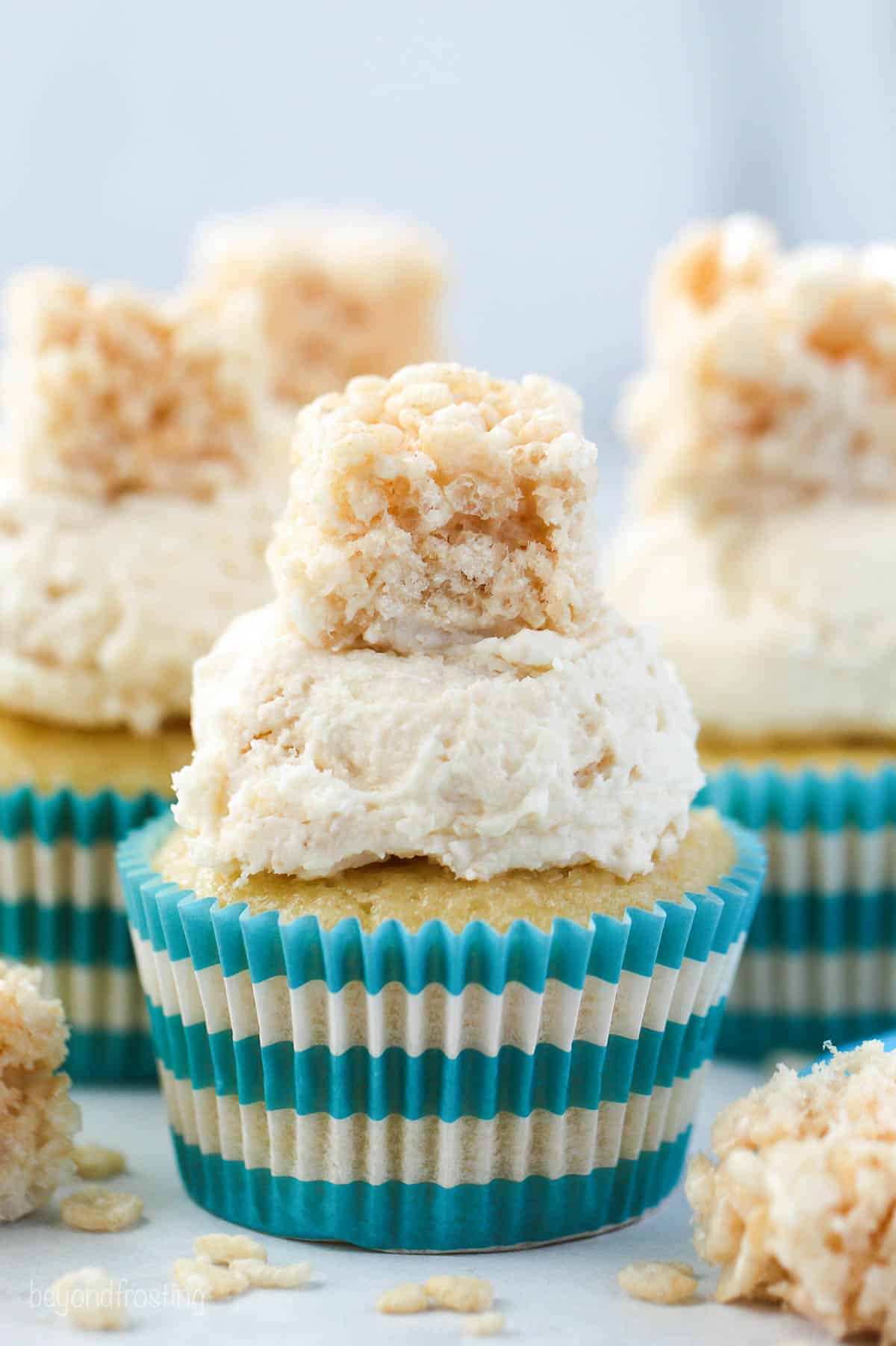 Four frosted cupcake with a mini Rice Krispie Treat on top