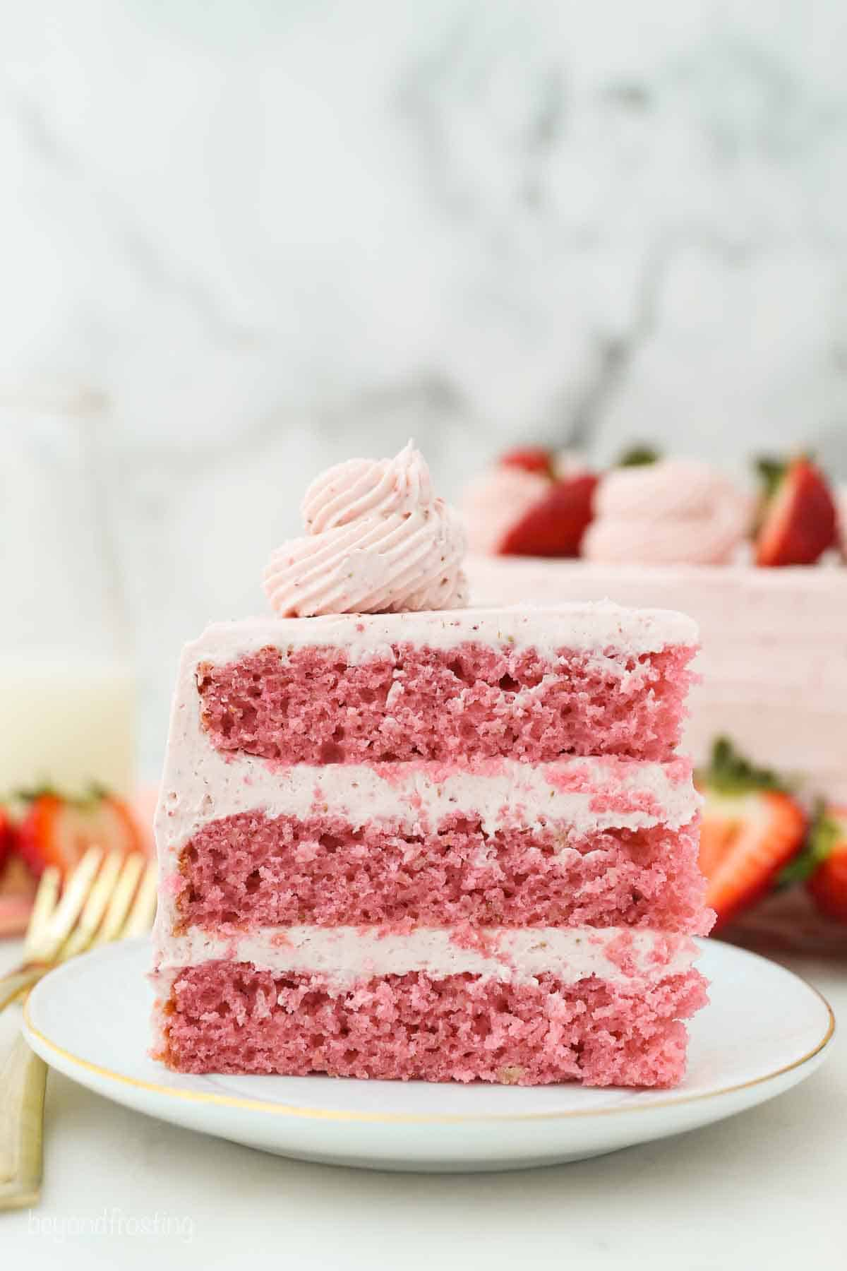 A slice of this three-layer Strawberry Cake with Strawberry Frosting.
