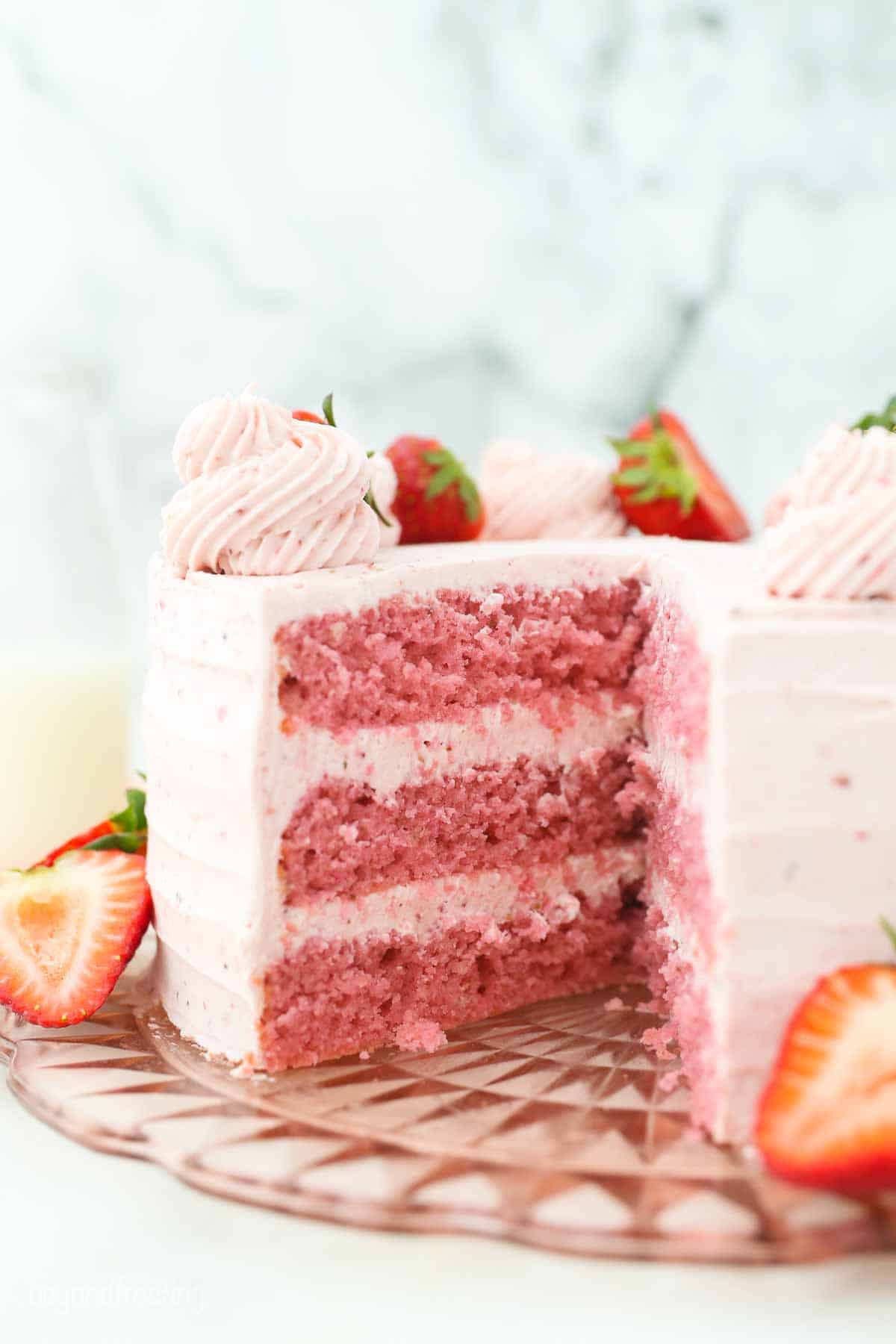 A Strawberry Cake with Strawberry Frosting and decorated with strawberries.