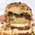 A loaf of sour cream coffee cake cut to show the inside