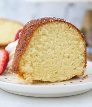 A piece of homemade pound cake sitting on a plate
