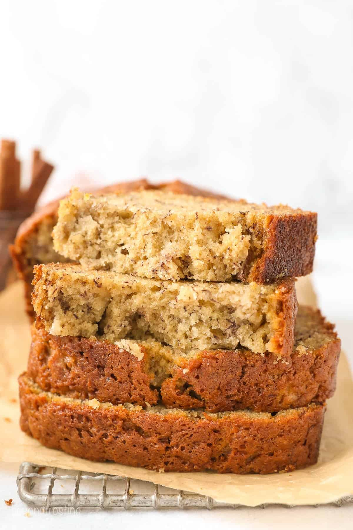 Four thick slices of banana bread stacked on top of each other.