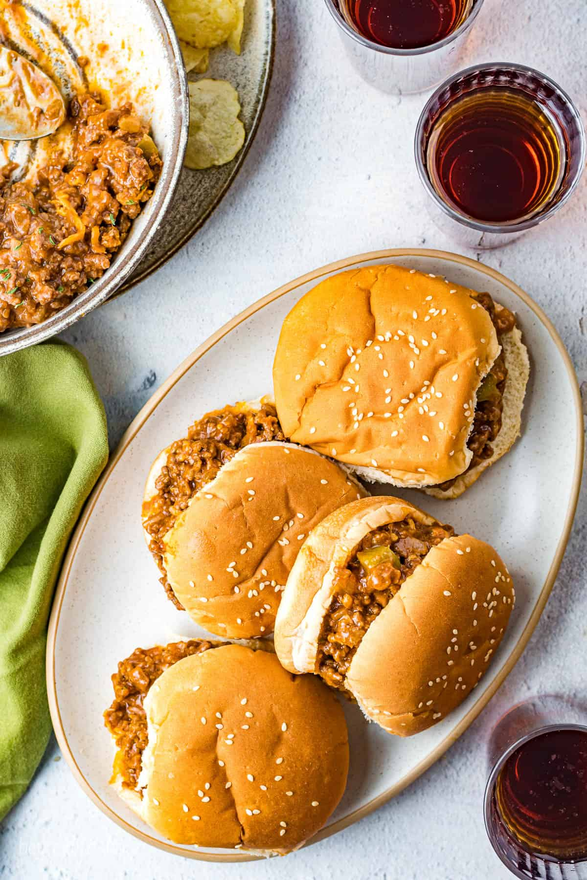 A platter of 4 finished Sloppy Joes.