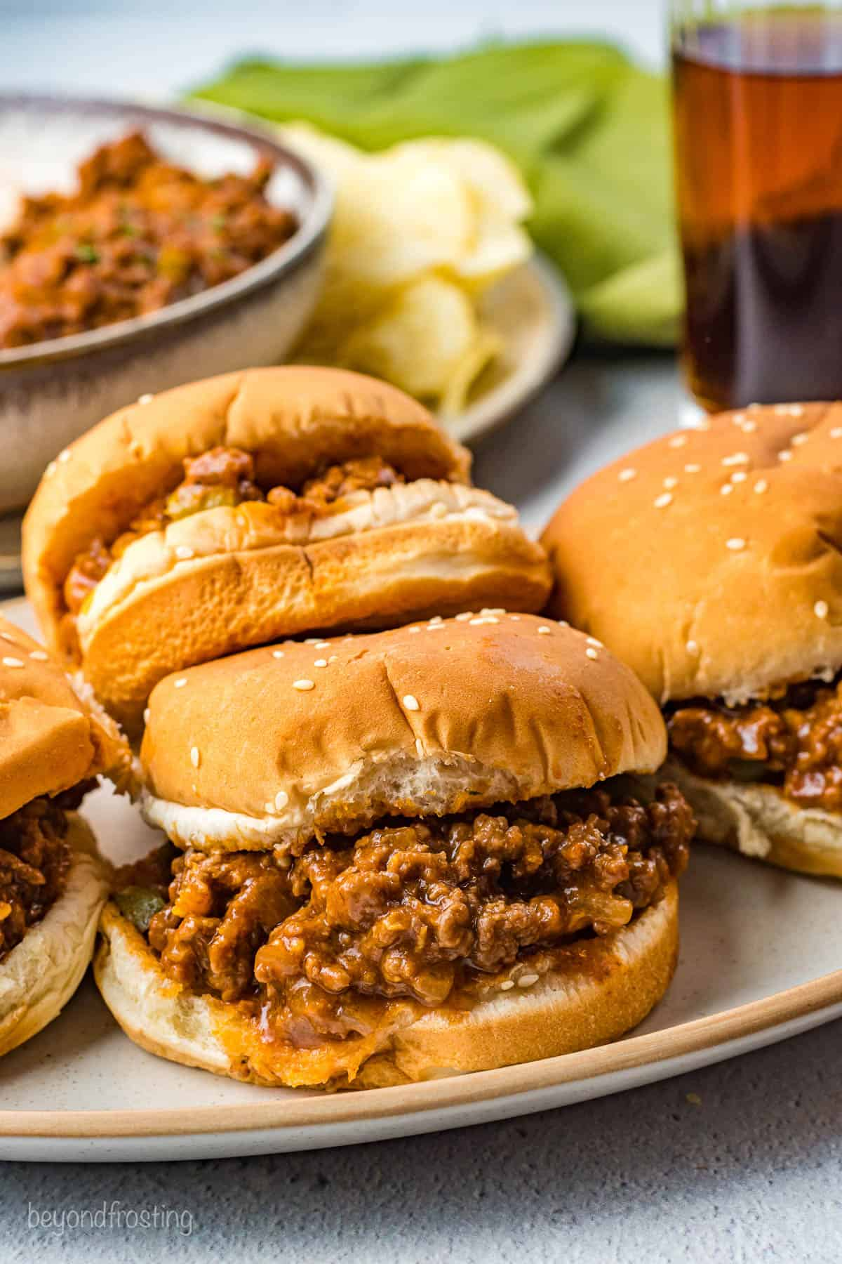 A side view of a platter of 4 finished Sloppy Joes.