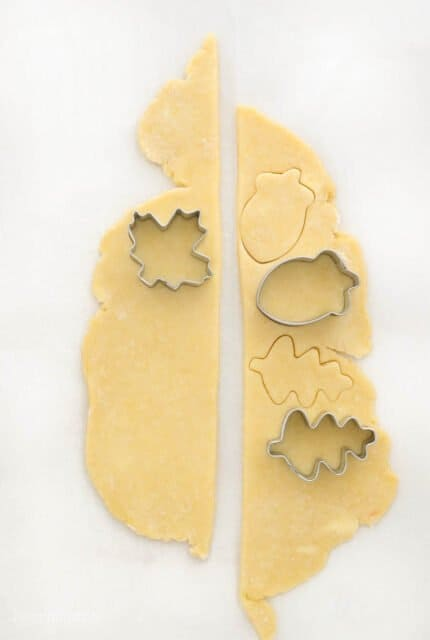 Extra pie dough with cut out shapes of leaves and acorn