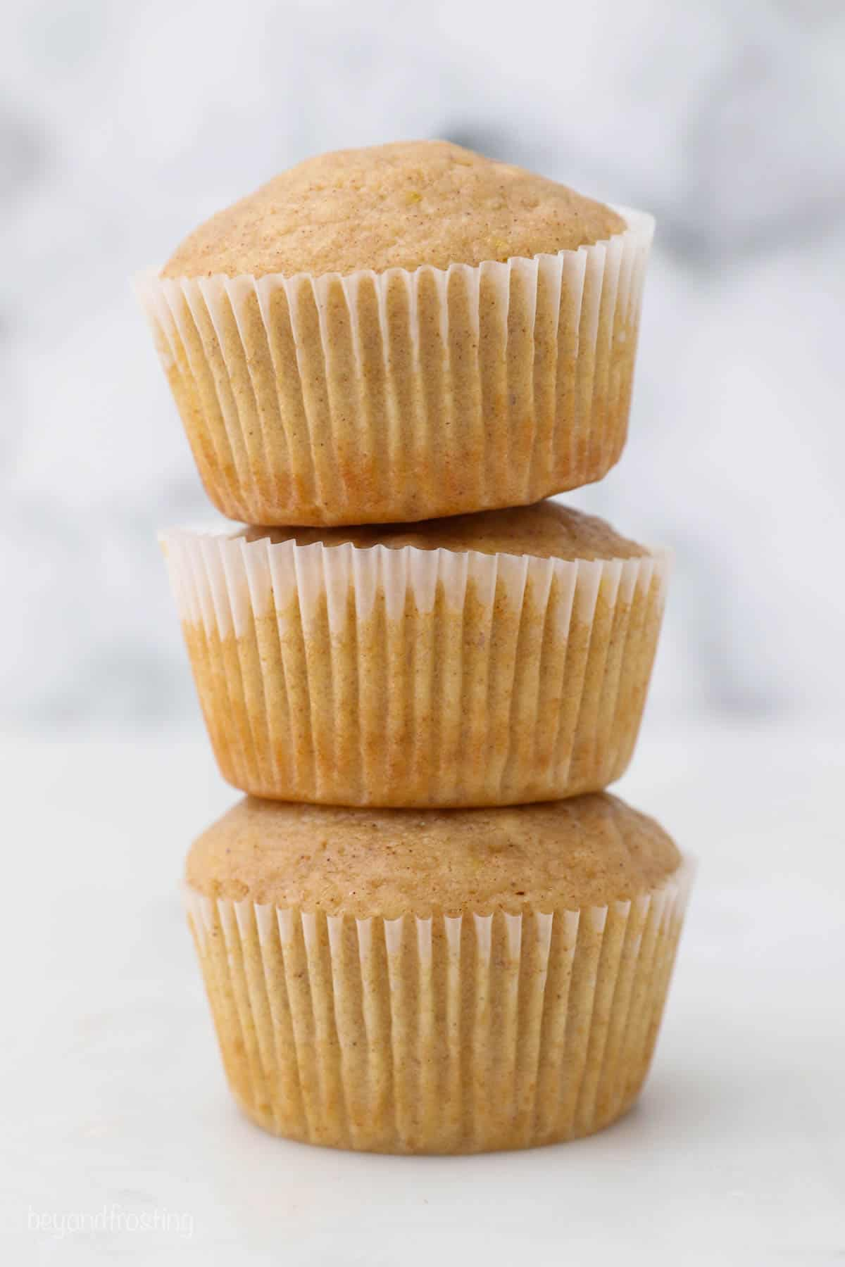 three apple cupcakes stacked