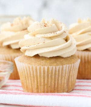 closeup of apple cupcakes topped with maple buttercream frosting