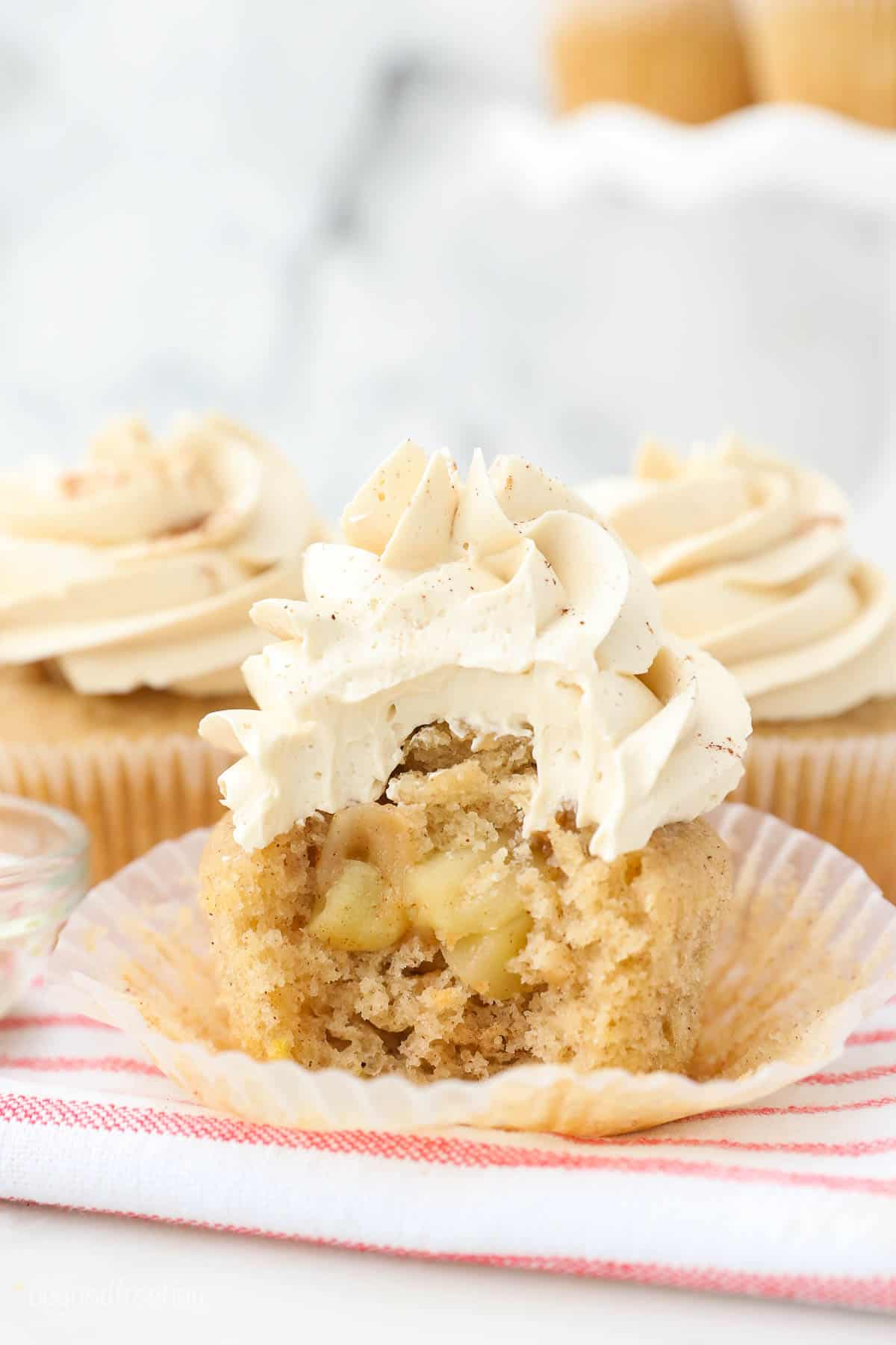 an apple pie cupcake with a bite taken out