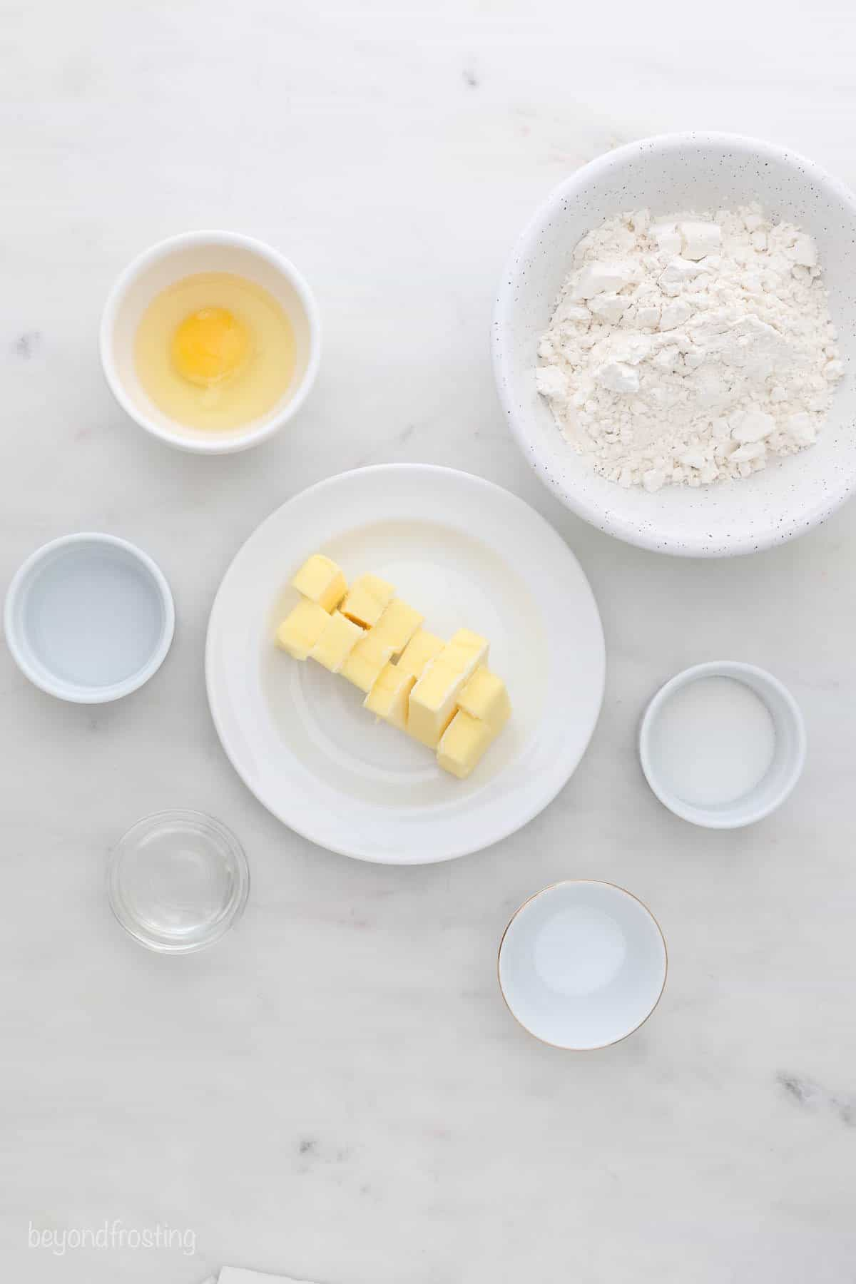 Ingredients for a gluten-free pie crust measured out into small bowls