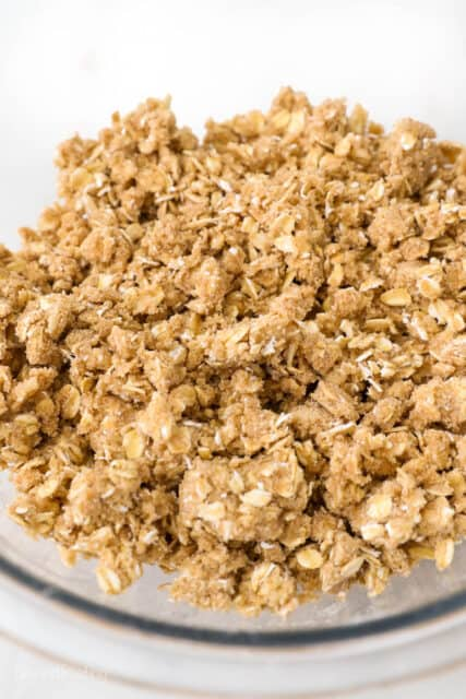 a glass mixing bowl of crumble topping