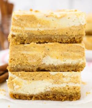 three stacked pumpkin cheesecake bars