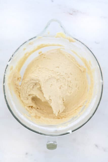 a glass mixing bowl with cake batter