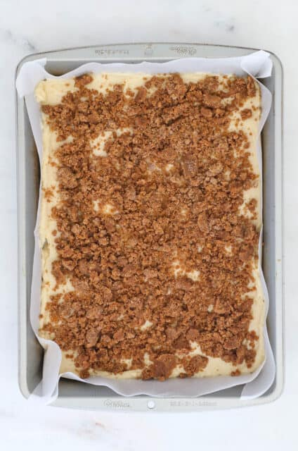 birds eye view of a pan with streusel topping over cake batter