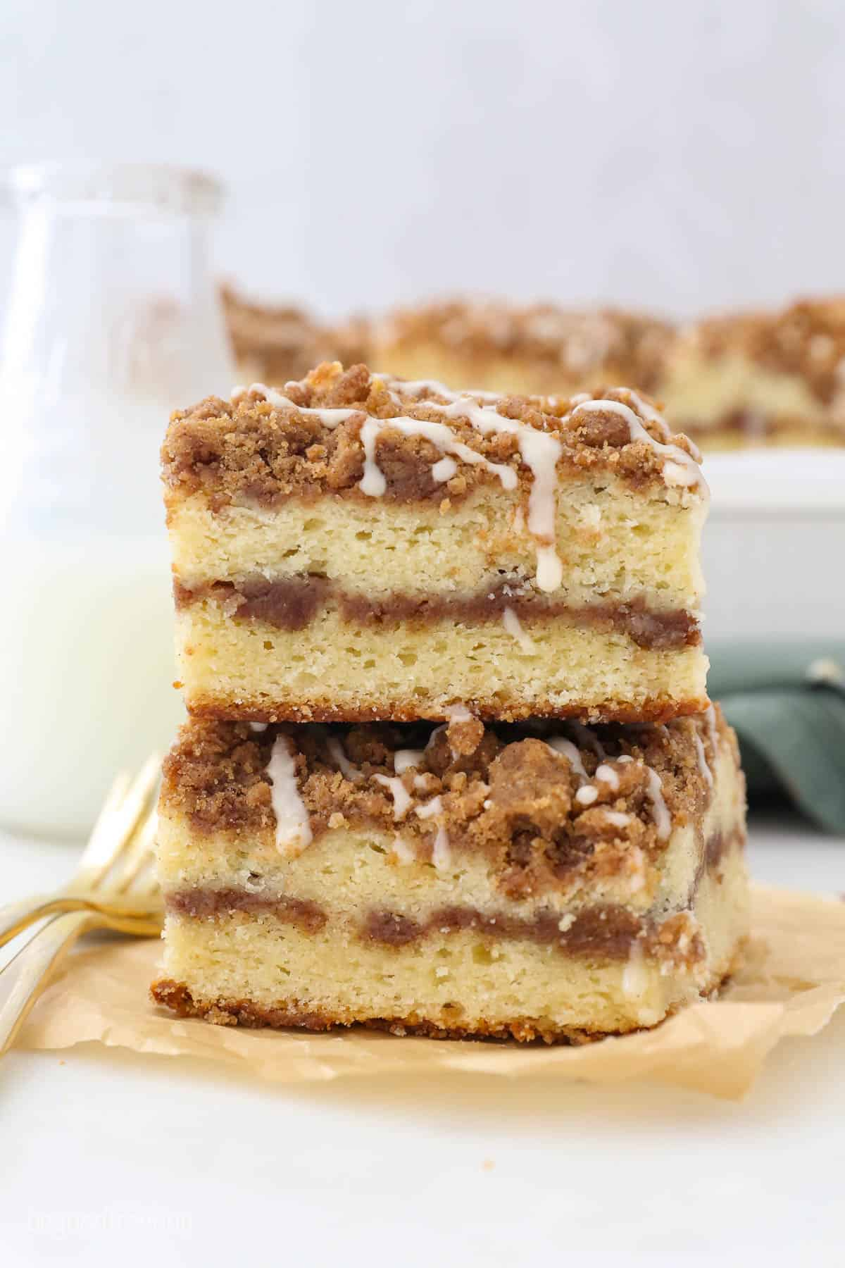 Two slices of layered coffee cake on a piece of brown parchment paper