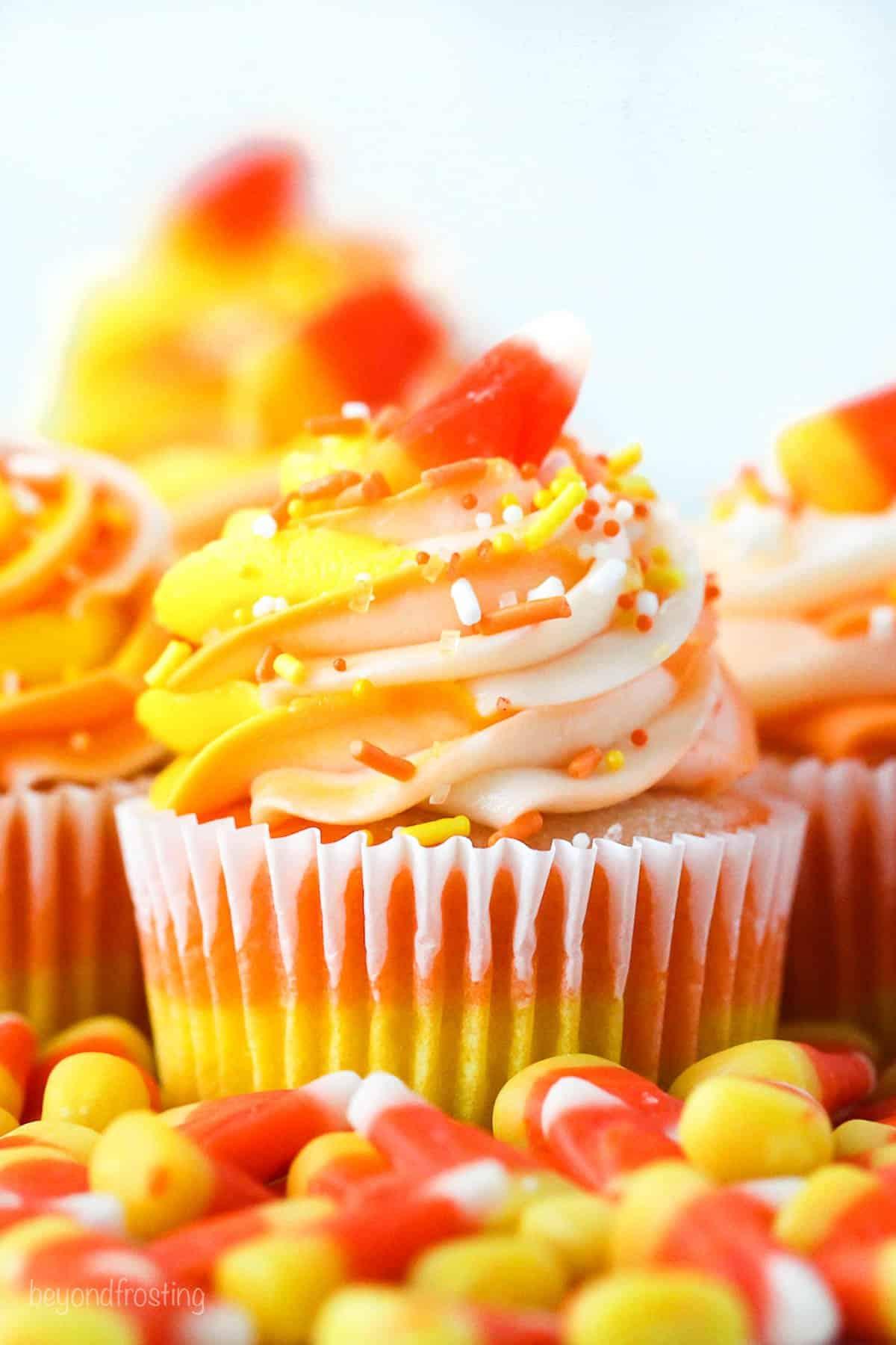 A cupcake decorated like a candy corn