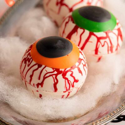 a close up of a halloween hot chocolate bomb decorated like an eyeball