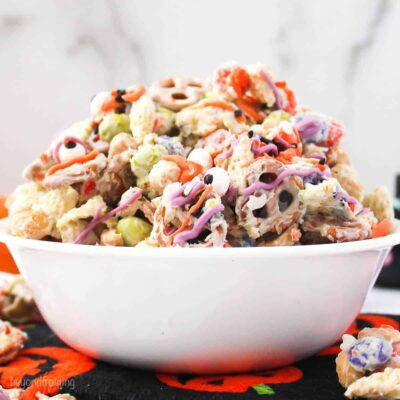 a white bowl filled with with a halloween snack mix